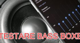 How do you test the bass from the speakers with your phone?